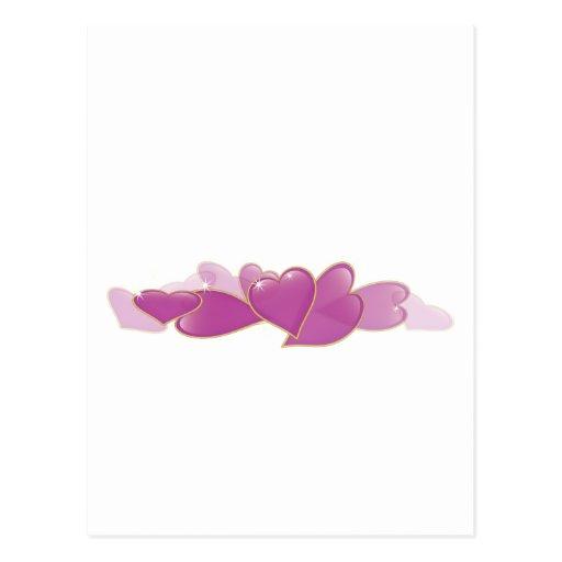 Pila de corazones rosados postales