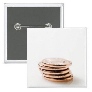 Pila de diez monedas del centavo pins