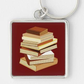Pila de libros - beige llavero cuadrado plateado