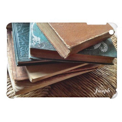 pila de libros en el mini caso del viejo iPad de l