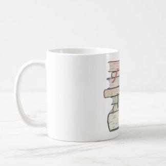 Pila de libros taza de café
