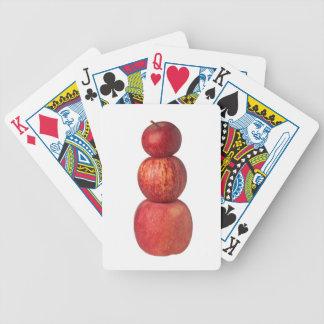 Pila de manzanas barajas de cartas