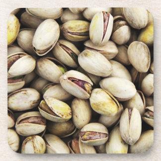 Pila de nuez del pistacho posavasos