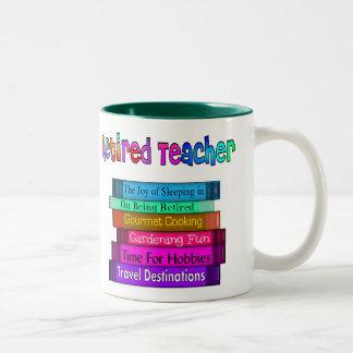 Pila jubilada de los regalos del profesor de taza dos tonos