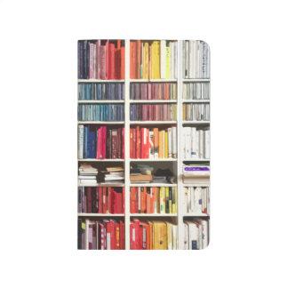Pilas coloridas de libros cuaderno