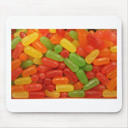 Píldoras coloridas del caramelo tapete de raton