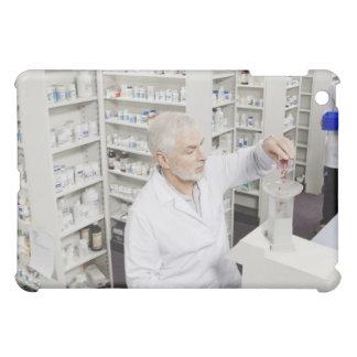Píldoras de colada del farmacéutico en la cuenta d