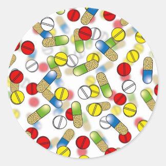 Píldoras que caen pegatina redonda