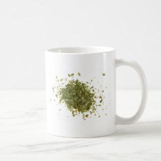 Pile of chopped coriander leaves coffee mug