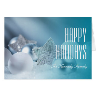 Pile of Christmas ornaments in snow Card