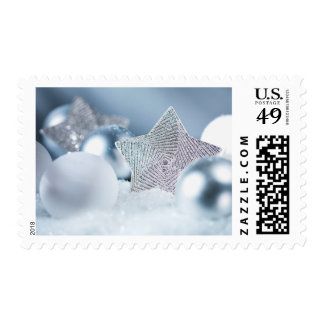 Pile of Christmas ornaments in snow Postage