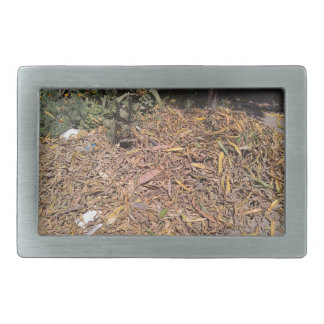 Pile of dried leaves and grass rectangular belt buckle