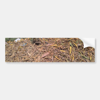 Pile of dried leaves and grass car bumper sticker