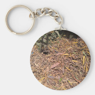 Pile of dried leaves and grass keychain