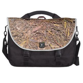 Pile of dried leaves and grass laptop messenger bag