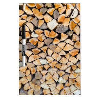 Pile of firewood as tree trunk dry erase board