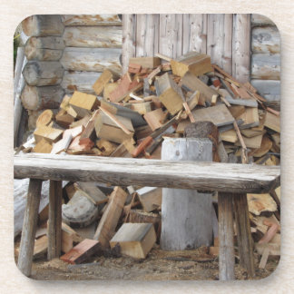 Pile of firewood next to hut cabin beverage coaster
