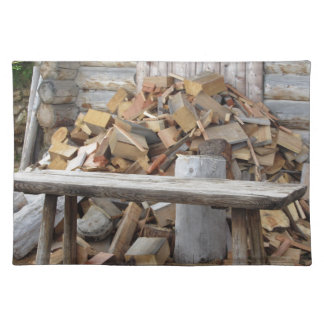 Pile of firewood next to hut cabin cloth placemat
