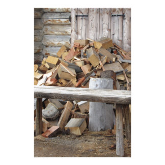 Pile of firewood next to hut cabin stationery