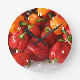 pile of habanero hot peppers top round clock