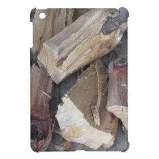 Pile of irregularly chopped firewood on old cart case for the iPad mini