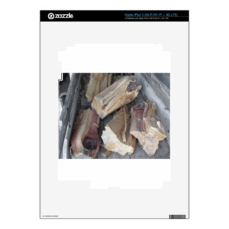 Pile of irregularly chopped firewood on old cart skin for iPad 3