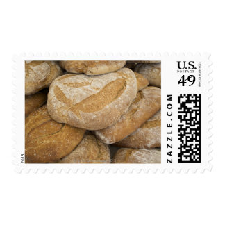Pile of large bread loaves postage