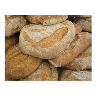 Pile of large bread loaves postcard