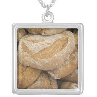 Pile of large bread loaves silver plated necklace