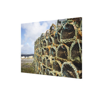 pile of lobster crab pots on Irish shoreline Canvas Print