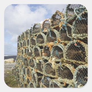 pile of lobster crab pots on Irish shoreline Stickers