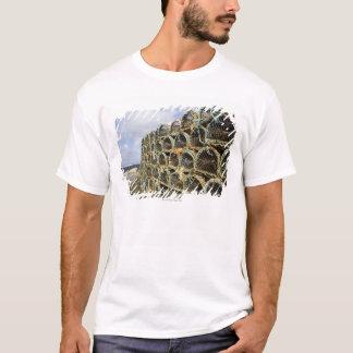pile of lobster crab pots on Irish shoreline T-Shirt