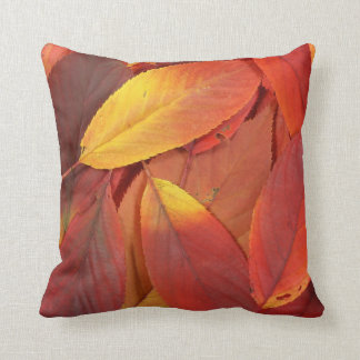 Pile of red autumn leaves closeup throw pillows
