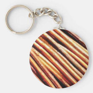 piles of copper pipes keychain