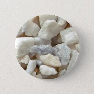 piles of stone gravel button