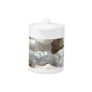 piles of stone gravel teapot