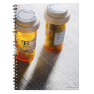 Pill bottles on stock page notebook