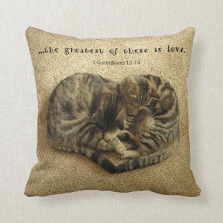 Pillow with cats in the shape of a heart.
