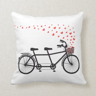Pillow with tandem bicycle and flying red hearts