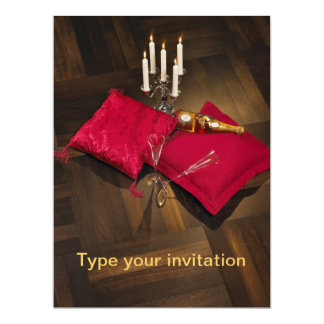 Pillows, candlesticks and champagne on dark parque card