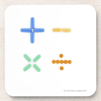 Pills in shape of plus sign, minus, beverage coaster