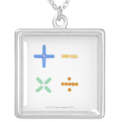 Pills in shape of plus sign, minus, square pendant necklace