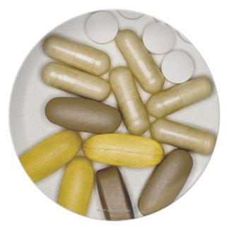 Pills on paper melamine plate