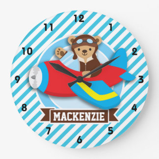 Piloto del oso de peluche en aeroplano rojo del reloj redondo grande