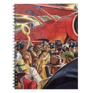 Piloto, mujer y aeroplano del vintage con los libro de apuntes