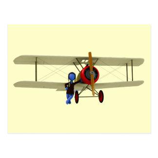 Piloto y biplano tarjeta postal