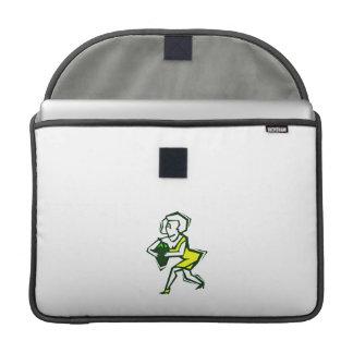Pimienta a disposición de la mujer amarilla en ves fundas macbook pro