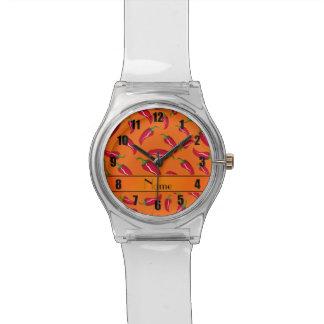 Pimienta de chile anaranjada conocida relojes