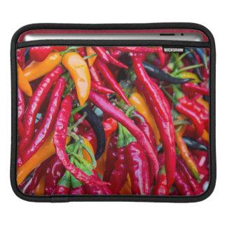 Pimientas del chile picante en el mercado de los funda para iPads