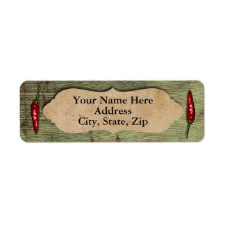 Pimientas rojas de madera viejas rústicas etiqueta de remite